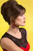 Fashion woman with earrings — Stock Photo