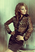 Woman in leopard clothes — Stockfoto