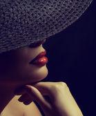 Woman in black posh hat — Stock Photo