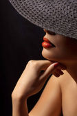Woman in black posh hat — Stock Photo