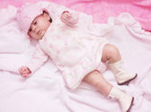 Baby girl in pink hat — Stock Photo