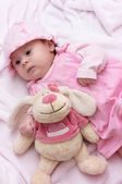 Baby girl with toy — Stock Photo