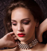 Woman in jewelry necklace — Stock Photo