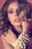 Woman with seashells bracelet — Stock Photo