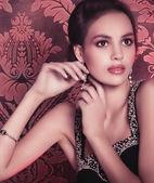 Woman in jewelry earrings — Stock Photo