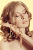 Blond woman with jewelry decoration — Stock Photo