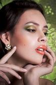 Woman in jewelry jewelry earrings — Stock Photo
