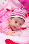 Beautiful baby girl on pink background — Photo
