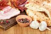 Smoked bacon with oil and spices — Stock Photo