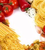 Italian raw pasta with tomatoes, cheese and spices — Stock Photo