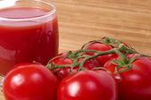 Tomatoes and tomato juice — Stock Photo