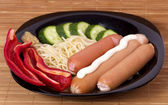 Spaghetti with sausages — Stock Photo