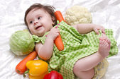 Cute little girl with green-stuffs — Stock Photo
