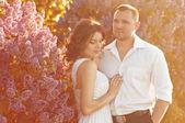 Newlyweds near the lilacs — Stock Photo
