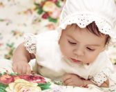 Cute little girl in dress and hat — Stock Photo