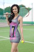 Beautiful woman playing tennis — Stock Photo
