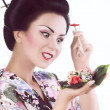 Woman with sushi — Stock Photo #49239973