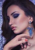 Woman in earrings — Stok fotoğraf