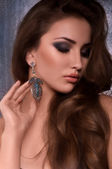 Woman in earrings — Stockfoto