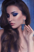 Woman in earrings — 图库照片