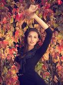 Girl in autumn garden — Stock Photo