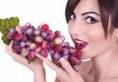 Woman with red grape — Stockfoto