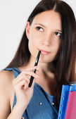 Girl with pen — Stock Photo