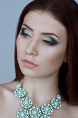 Woman with makeup and precious decorations — Foto de Stock