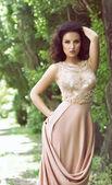 Woman in pastel long dress — Stock Photo