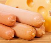 Sausages and cheese — Stock Photo