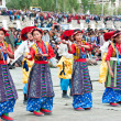 Youth in traditional Tibetan clothes performing folk dance — Foto de Stock