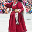 Woman in traditional Tibetan clothes performing folk dance — Stock Photo