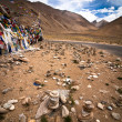 Highland road pass with Buddhist praying flags — Stock Photo
