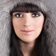 Royalty-Free Stock Photo: Portrait of young beautiful woman in winter furry hat
