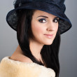Retro style portrait of beautiful woman in vintage hat — Stock Photo #19189057