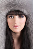 Portrait of young beautiful woman in winter furry hat — Stock Photo