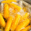 Corn ear boiling in pot at outdoor marketplace. Thailand — Stock Photo
