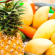Selling tropical fruits and vegetables at market. Close up pinea — Stock Photo #23580769