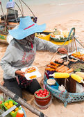 Thai woman selling traditional food at beach — Stock Photo