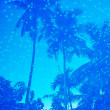 Blue water of resort swimming pool with palm trees reflection — Stock Photo #23953843