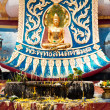 Golden statue of Buddha in meditation (Thursday) with offerings — Stock Photo