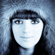 Winter portrait of young beautiful woman in furry hat  — Stock Photo