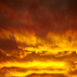 Stock Photo: Dramatic background with cloudy sky at burning sunset