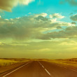 Empty asphalt road under dramatic sunset  cloudy sky — Stock Photo