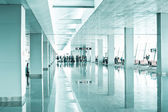 Travel concept. Passengers in the modern airport terminal — Stock Photo