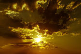 Dramatic background with cloudy sky at sunset — Stock Photo