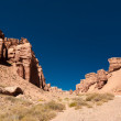 Stock Photo: Rock formations at Charyn canyon under blue sky. Kazakhstan