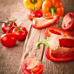 Fresh organic tomatoes and paprika — Stock Photo