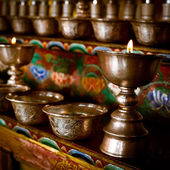 Burning oil lamps at Buddhist monastery — Stock Photo