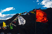 Buddhist praying flags flapping in the wind. India — Stock Photo